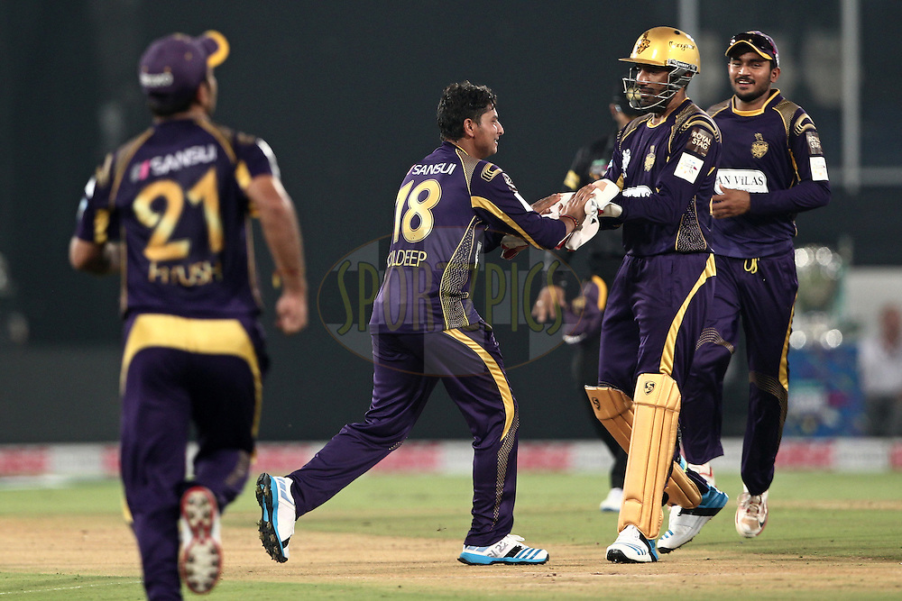Robin Uthappa , Suryakumar Yadav of the Kolkata Knight Riders celebrates the wicket of  Mitchell Marsh of Perth Scorchers during match 10 of the Oppo Champions League Twenty20 between the Kolkata Knight Riders and the Perth Scorchers held at the Rajiv Gandhi Cricket Stadium, Hyderabad, India on the 24th September 2014<br /> <br /> Photo by:  Deepak Malik / Sportzpics/ CLT20<br /> <br /> <br /> Image use is subject to the terms and conditions as laid out by the BCCI/ CLT20.  The terms and conditions can be downloaded here:<br /> <br /> http://sportzpics.photoshelter.com/gallery/CLT20-Image-Terms-and-Conditions-2014/G0000IfNJn535VPU/C0000QhhKadWcjYs