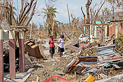Women look at destruction on a street near Port Salut, Haiti, on October 9, 2016. Photo by Patrick Farrell/Miami Herald/TNS/ABACAPRESS.COM