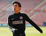 Charlton Athletic Yun Suk-Young (2) warming up during the Sky Bet Championship match between Charlton Athletic and Middlesbrough at The Valley, London, England on 13 March 2016. Photo by Andy Walter.