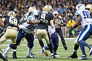 NEW ORLEANS, LA - NOVEMBER 8:  Drew Brees #9 of the New Orleans Saints is sacked by Jurrell Casey #99 of the Tennessee Titans at Mercedes-Benz Superdome on November 8, 2015 in New Orleans, Louisiana.  The Titans defeated the Saints in overtime 34-28.  (Photo by Wesley Hitt/Getty Images) *** Local Caption *** Drew Brees; Jurrell Casey