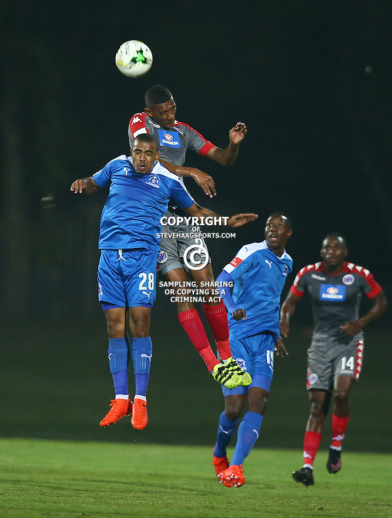 Mario Booysen of SuperSport United out jumps Deolan Mekoa of Maritzburg Utd during the 2016 Premier Soccer League match between Maritzburg Utd and SuperSport United held at the Harry Gwala Stadium in Pietermaritzburg, South Africa on the 21st September 2016<br /> <br /> Photo by:   Steve Haag / Real Time Images