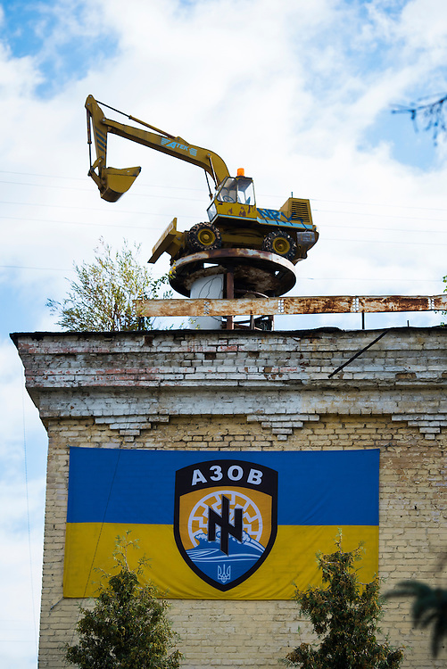 A minitaure backhoe is seen atop a building at an Azov Battalion base on September 9, 2015 in Kyiv, Ukraine. The base formerly produced tractors and construction equipment, this model dates to when the factory was still producing vehicles.