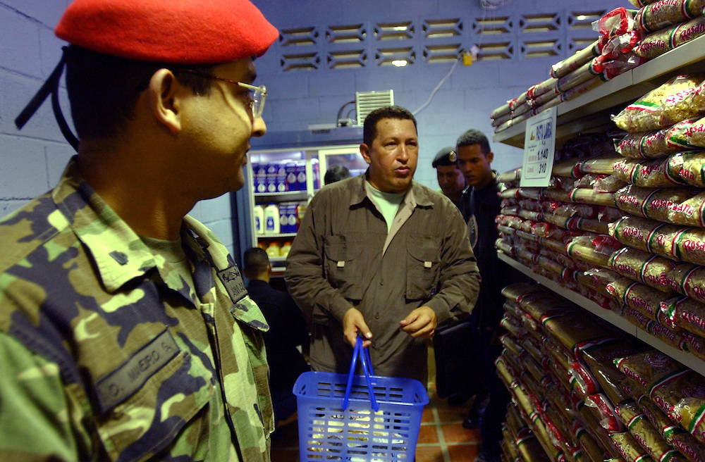 President Hugo Chavez tours a government subsidized market called Mercal after the market's inaguration.