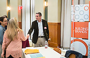 Matt Freedman of Ologie greets visitors during the CCN Expo in Walter Hall Rotunda on Wednesday, May 13, 2015.  Photo by Ohio University  /  Rob Hardin