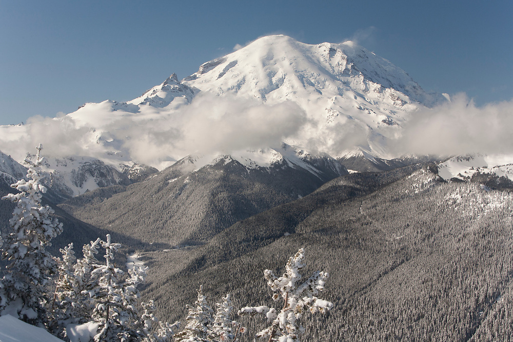 North America, United States, Washington, snow-covered Mt. Rainier and White River, viewed from Crystal Mountain