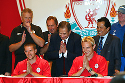 BANGKOK, THAILAND - Thursday, July 22, 2003: Liverpool's l-r Rick Parry, Michael Owen, manager Gerard Houllier and captain Sami Hyypia bow at a press conference at the Merchant Court Hotel in Bangkok, ahead of their preseason match against Thailand. Also pictured the Thai national team manager Twatchai Sajjakul (3rd from left) and national secratary Worawi Makudi. (Pic by David Rawcliffe/Propaganda)