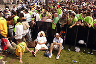 """PHILADELPHIA - JULY 02:  Fans wait for the show to begin at """"Live 8 Philadelphia"""" at the Philadelphia Museum of Art July 2, 2005 in Philadelphia, Pennsylvania. The free concert is one of ten simultaneous international gigs including London, Berlin, Rome, Paris, Barrie, Tokyo, Cornwall, Moscow and Johannesburg. The concerts precede the G8 summit (July 6-8) to raising awareness for MAKEpovertyHISTORY.  (Photo by William Thomas Cain/Getty Images)"""