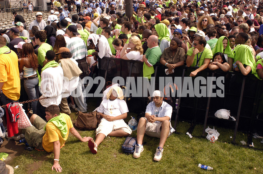 "PHILADELPHIA - JULY 02:  Fans wait for the show to begin at ""Live 8 Philadelphia"" at the Philadelphia Museum of Art July 2, 2005 in Philadelphia, Pennsylvania. The free concert is one of ten simultaneous international gigs including London, Berlin, Rome, Paris, Barrie, Tokyo, Cornwall, Moscow and Johannesburg. The concerts precede the G8 summit (July 6-8) to raising awareness for MAKEpovertyHISTORY.  (Photo by William Thomas Cain/Getty Images)"