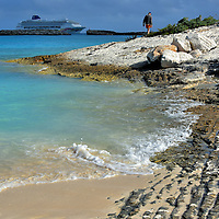 Geological Evolution of Shoreline at Great Stirrup Cay, Bahamas<br /> As you walk along the rocky shoreline of Great Stirrup Cay, look down to appreciate its geological evolution. The island&rsquo;s formation began about 300 to 400 million years ago during the tectonic shift of North America away from Africa. In the Jurassic era, about 160 million years ago, dead marine life began building up as sentiment. These deposits formed into oolite, a substance used in cement and glass making. Within the last 900,000 to 120 years, this material became reefs and then the mass emerged from the sea as islands. A close inspection will reveal fossilized shells and tiny skeletons. This historical evidence is more pronounced during extreme low tides when the sea floor can be exposed for miles at the south end of the island.