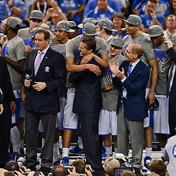 Apr 2, 2012; New Orleans, LA, USA; Kentucky Wildcats Anthony Davis and head coach John Calipari celebrate with teammates following a national championship game win over the Kansas Jayhawks 67-59 in the finals of the 2012 NCAA men's basketball Final Four at the Mercedes-Benz Superdome. Mandatory Credit: Derick E. Hingle-US PRESSWIRE