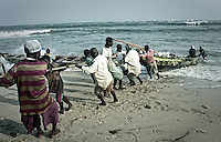 Pulling the boats in, fishermen, Kenya