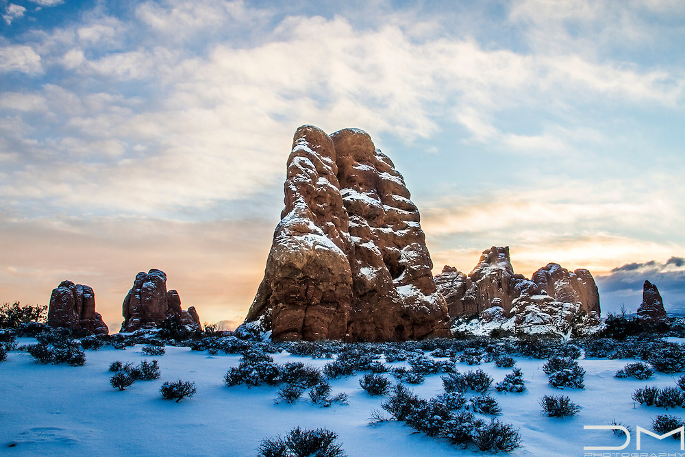 Landscape at sunrise after a big snow storm in Arches National Park, UTah.