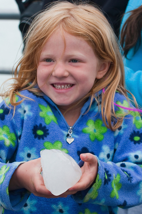A cute young girl holds onto a piece of ice recently calved from a glacier in Glacier Bay National Park. MR MRA