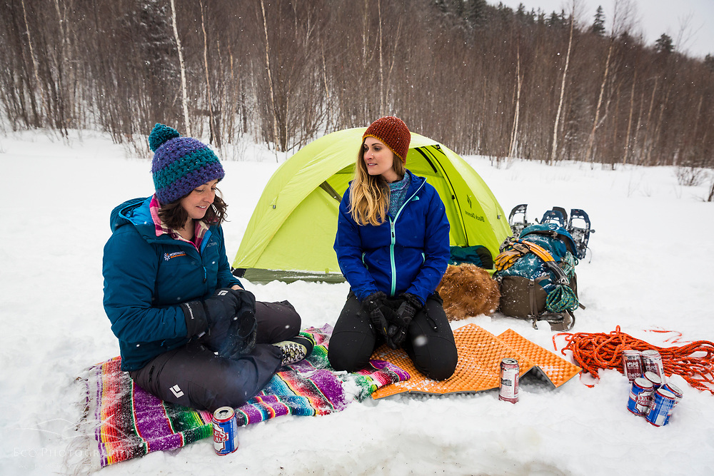 Two women winter camping in New Hampshire's White Mountains. Randolph Community Forest.