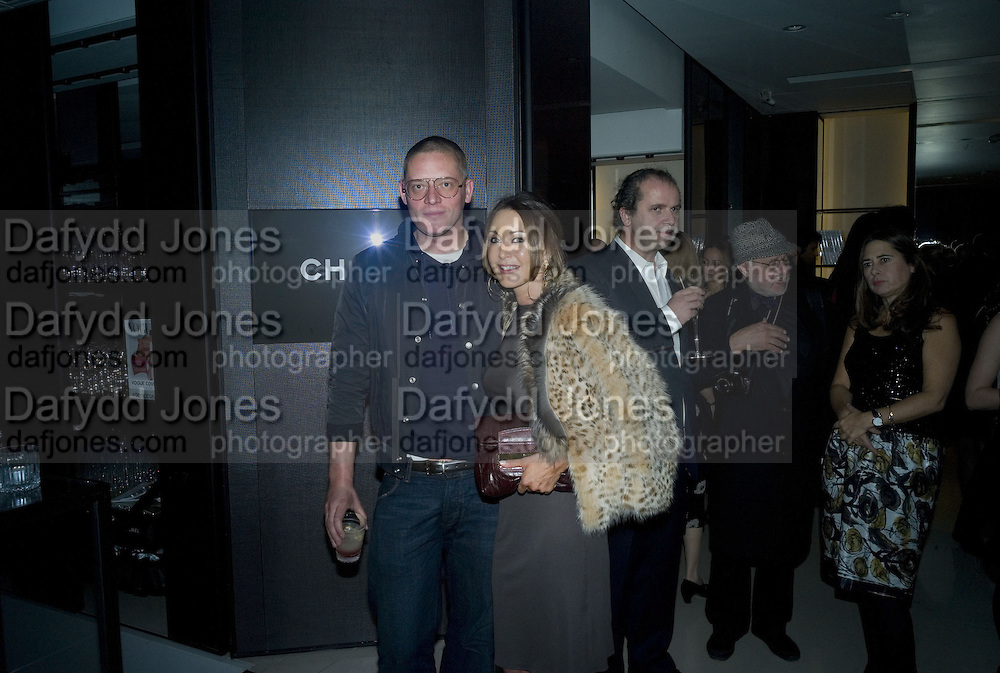 "Giles Deacon and Tamara Mellon, ""Vogue"" Covers: by Robin Derrick  and  Robin Muir. Chanel. Brompton Rd. London. 17 October 2007. -DO NOT ARCHIVE-© Copyright Photograph by Dafydd Jones. 248 Clapham Rd. London SW9 0PZ. Tel 0207 820 0771. www.dafjones.com."