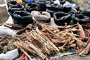 Africa, Tanzania, Frontier Market selling spices and herbs The goods are placed on a blanket on the ground