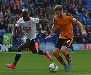 James Henry looks to skip past Wellington Silva in the final stages  during the Sky Bet Championship match between Bolton Wanderers and Wolverhampton Wanderers at the Macron Stadium, Bolton, England on 12 September 2015. Photo by Mark Pollitt.