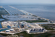 Turkey Point's nuclear reactors and oil- and natural gas-fired electric generators provide electricity to 450,000 homes.  It has a closed cooling system of 36 interconnected canals to cool the steam-powered turbines.