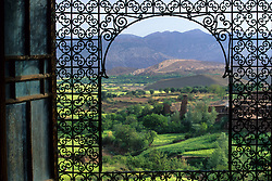 Africa, Morocco, near Tizi n' Tichka Pass, View from window with iron grille (moucharabieh), Telouet Kasbah (19th c.)