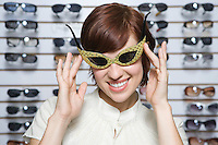 Portrait of young woman swearing glasses in shop