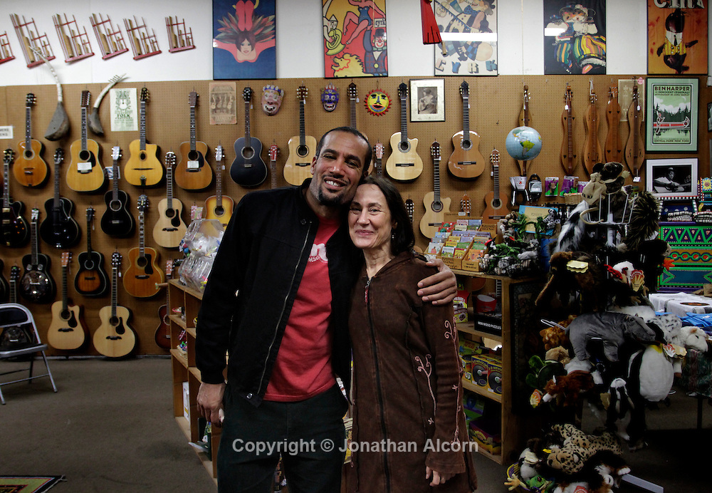"Ben Harper and his mother Ellen Chase-Verdries, pose together at his family's music store ""Folk Music Center"" in Claremont, California, on December 8, 2012. ©Jonathan Alcorn/JTA."