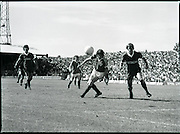 League of Ireland vs Liverpool FC.    (M87)..1979..18.08.1979..08.18.1979..18th August !979..In a pre season friendly the League of Ireland took on Liverpool FC at Dalymount Park Phibsborough,Dublin. The league team was made up of a selection of players from several League of Ireland clubs and was captained by the legendary John Giles. Liverpool won the game by 2 goals to nil..The scorers were Hansen and McDermott...Photograph shows Noel Synnott and Kenny Dalglish Battling for control of the ball.