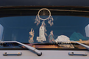 Religious icons behind the windscreen of a truck with the touring Corrida de touros (bullfight) at Caldas da Rainha, Portugal. Unlike Spanish bullfights, in the Portuguese version, they do not kill the bull.