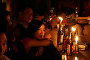 beautiful chinese woman by candlelight in bar