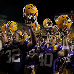 19 September 2009: LSU Tigers teammates Charles Scott (32) and Rocky Duplessis (40) sing following a 31-3 win by the LSU Tigers over the University of Louisiana Lafayette Ragin' Cajuns at Tiger Stadium in Baton Rouge, Louisiana.