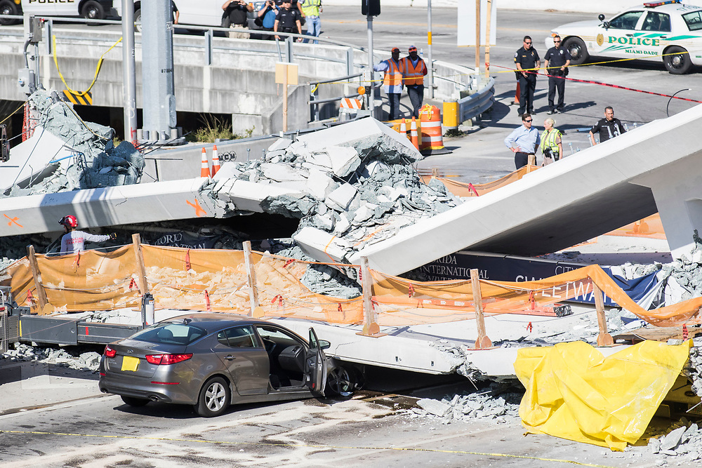 New pedestrian bridge at south Florida college collapses leaving vehicles trapped underneath and at least four people dead on Thursday, March 15, 2018. <br /> <br /> photo by Samuel Navarro