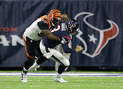 Houston Texans quarterback Tom Savage (3) is sacked by Cincinnati Bengals defensive tackle Geno Atkins (97) during the first half of an NFL football game Saturday, Dec. 24, 2016, in Houston. (AP Photo/Sam Craft)