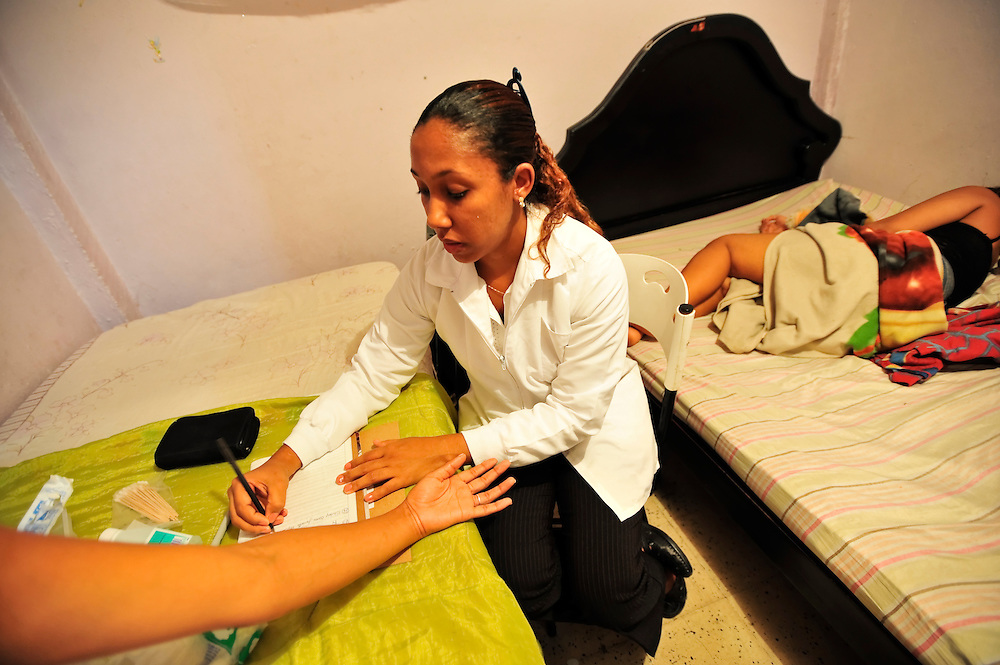STD testing in a brothel in Cartagena, Colombia. A sex scandal erupted recently when secret service agents were found bringing prostitutes to their hotel rooms while in Cartagena preparing for President Barack Obama's arrival to the Summit of the Americas