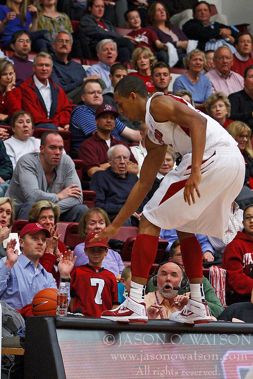 Feb 16, 2012; Stanford CA, USA; Stanford Cardinal forward/center Josh Owens (13) chases a loose ball over the scorers table against the Oregon State Beavers during the second half at Maples Pavilion.  Mandatory Credit: Jason O. Watson-US PRESSWIRE