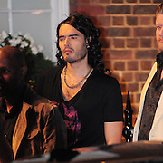 19.AUGUST.2009 - LONDON<br /> <br /> RUSSELL BRAND WEARING GOLD SHOES ON THE SET OF HIS NEW FILM GET HIM TO THE GREEK IN WHICH HE PLAYS A BRITISH ROCKSTAR AND INBETWEEN FILMING RUSSELL WAS CONSTANTLY SURROUDED BY WOMEN WHO ARE EXTRAS IN THE FILM BUT LOOKED LIKE HE HAD GOT THE NUMBER OF ONE LUCKY LADY.<br /> <br /> BYLINE: EDBIMAGEARCHIVE.COM<br /> <br /> *THIS IMAGE IS STRICTLY FOR UK NEWSPAPERS & MAGAZINES ONLY*<br /> *FOR WORLDWIDE SALES & WEB USE PLEASE CONTACT EDBIMAGEARCHIVE - 0208 954 5968*