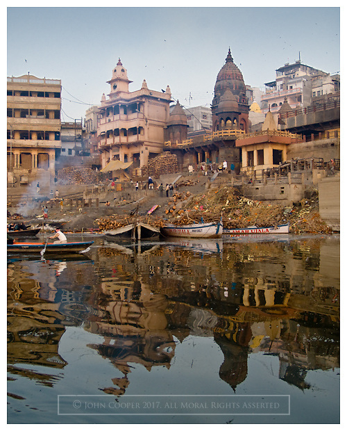 Funeral Ghats and boats on the river Ganges at Varanasi, India.
