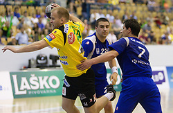 Nejc Poklar of Celje vs Goran Gorenac and Marko Radelj of Trimo during handball match between RK Celje Pivovarna Lasko and Trimo Trebnje of last Round of 1st Slovenian Handball league, on May 27, 2011 in Arena Zlatorog, Celje, Slovenia. Celje defeated Trimo 32-28 and win 3rd place in Slovenian National Championship. (Photo By Vid Ponikvar / Sportida.com)