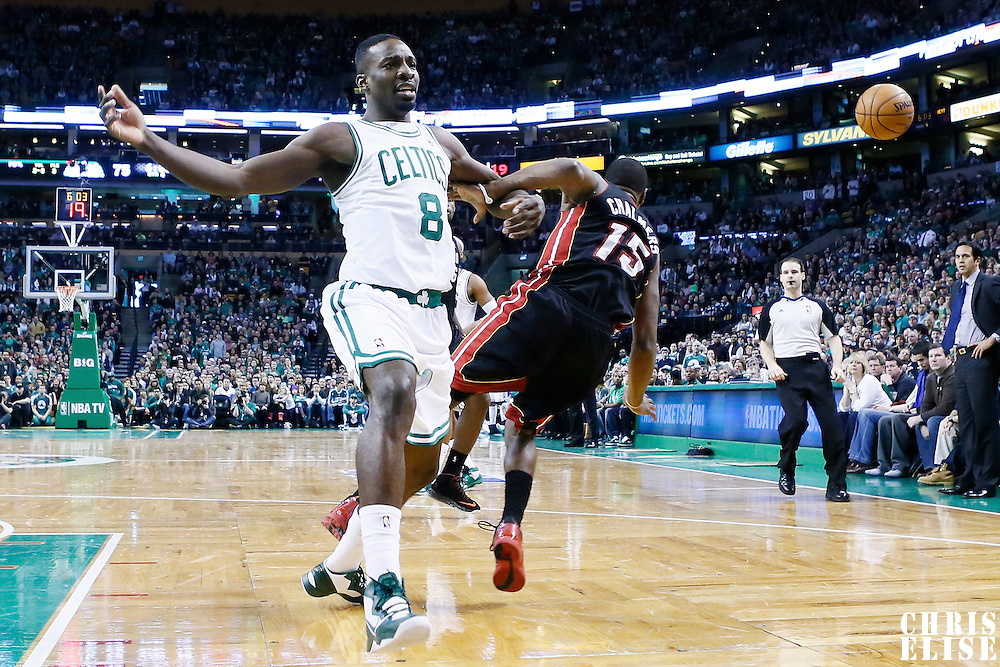 27 January 2013: Boston Celtics power forward Jeff Green (8) reacts as he is fouled by Miami Heat point guard Mario Chalmers (15) during the Boston Celtics 100-98  2OT victory over the Miami Heat at the TD Garden, Boston, Massachusetts, USA.