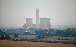 Image ©Licensed to i-Images Picture Agency. 27/07/2014. Didcot, United Kingdom. The landmark cooling towers of Didcot power station demolished at dawn. Picture by i-Images