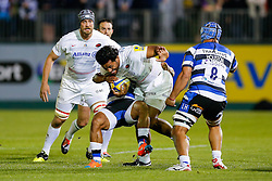 Saracens Number 8 Billy Vunipola is tackled by Bath Inside Centre Kyle Eastmond as he hands off Number 8 Leroy Houston - Photo mandatory by-line: Rogan Thomson/JMP - 07966 386802 - 03/10/2014 - SPORT - RUGBY UNION - Bath, England - The Recreation Ground - Bath Rugby v Saracens - Aviva Premiership.