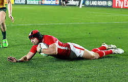 © SPORTZPICS/ Seconds Left Images 2011 - Wales' Leigh Halfpenny dives over to score a try at the death Wales v Australia - Rugby World Cup 2011 - Bronze Final - Eden Park - Auckland - New Zealand - 21/10/2011 -  All rights reserved..