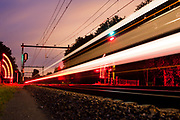 Train travels through remote forrest at night