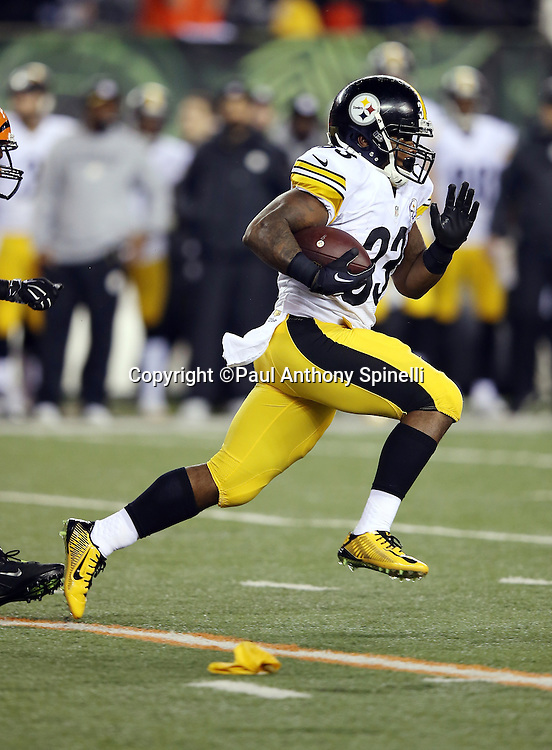 Pittsburgh Steelers running back Fitzgerald Toussaint (33) runs past a penalty flag as he catches a pass and runs for a gain of 27 yards and a first down at the Steelers 47 yard line on a third down play during the NFL AFC Wild Card playoff football game against the Cincinnati Bengals on Saturday, Jan. 9, 2016 in Cincinnati. The Steelers won the game 18-16. (©Paul Anthony Spinelli)