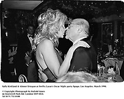 Sally Kirkland & Ahmet Ertegun at Swifty Lazar's Oscar Night party. Spago. Los Angeles. March 1990.<br />