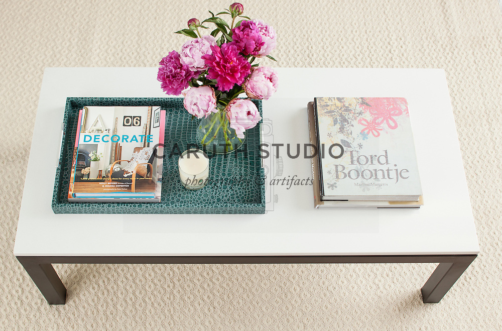 How to Style a Coffee Table: step 4, addsmaller vertical accent piece