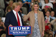 Republican presidential candidate billionaire Donald Trump introduces his daughter Ivanka during a campaign rally at the Myrtle Beach Convention Center November 24, 2015 in Myrtle Beach, South Carolina.