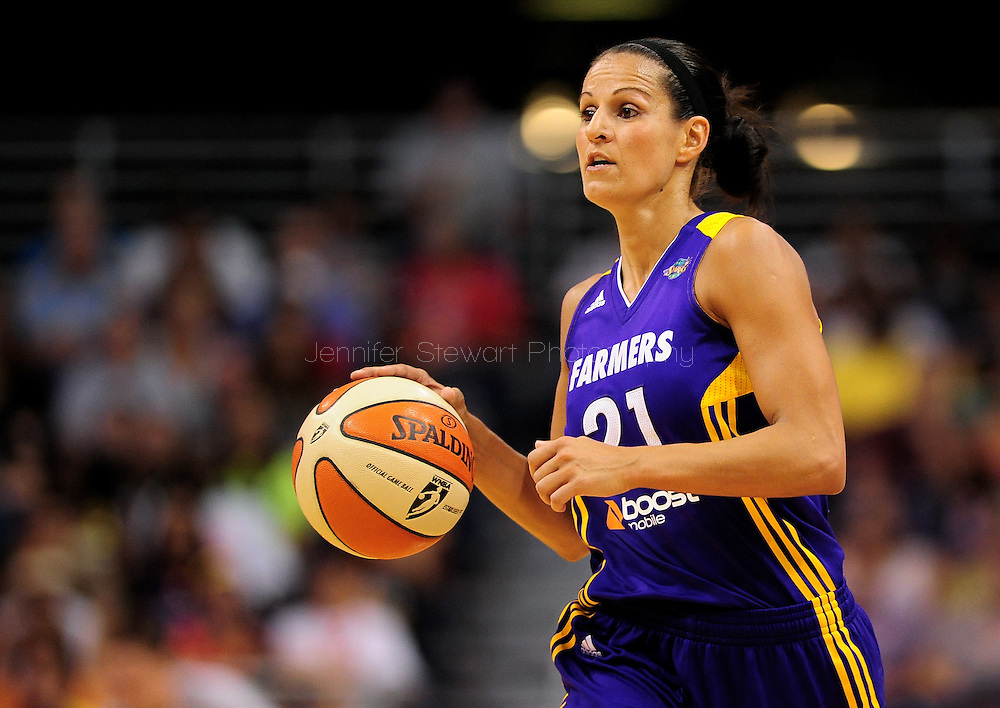 Sep 3, 2011; Phoenix, AZ, USA; Los Angeles Sparks guard Ticha Penicheiro (21) handles the ball against the Phoenix Mercury during the second half at the US Airways Center. The Mercury defeated the Sparks 93-77.  Mandatory Credit: Jennifer Stewart-US PRESSWIRE