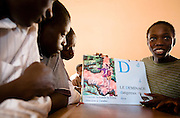 Students look at a visual dictionary during a class on mine awareness at the Nyassia primary school in the village of Nyassia, Senegal, on Thursday June 14, 2007.