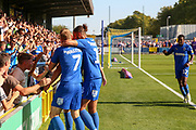 AFC Wimbledon attacker Marcus Forss (15) celebrating after scoring goal to make it 1-0 o<br /> with crowd during the EFL Sky Bet League 1 match between AFC Wimbledon and Bristol Rovers at the Cherry Red Records Stadium, Kingston, England on 21 September 2019.