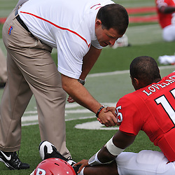 Sep 7, 2009; Piscataway, NJ, USA; Rutgers head coach Greg Schiano shakes hands with quarterback Jabu Lovelace (15) during warmups for Rutgers game against Cincinnati in NCAA college football at Rutgers Stadium.