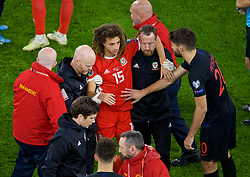 CARDIFF, WALES - Sunday, October 13, 2019: Wales' Ethan Ampadu is assisted by physiotherapist Sean Connelly (L) and Medical Officer Doctor Jon Houghton as he walks off the pitch with an injury during the UEFA Euro 2020 Qualifying Group E match between Wales and Croatia at the Cardiff City Stadium. (Pic by Paul Greenwood/Propaganda)